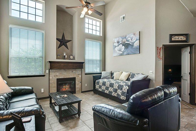 Sala de estar com sofá-cama individual e sofá-cama