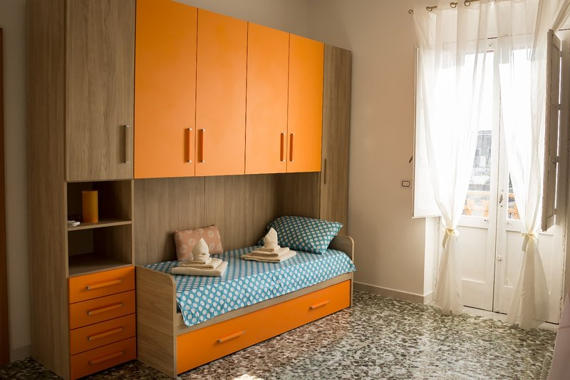 Deck wardrobe with standard single beds and memory mattresses