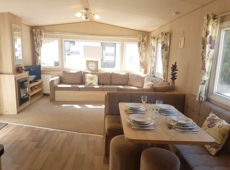 Our Lovely 3 bedroom 8 berth caravan light and airy with lots of room to relax and enjoy