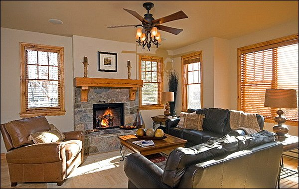 Bright Living Room with One of the Two Fireplaces