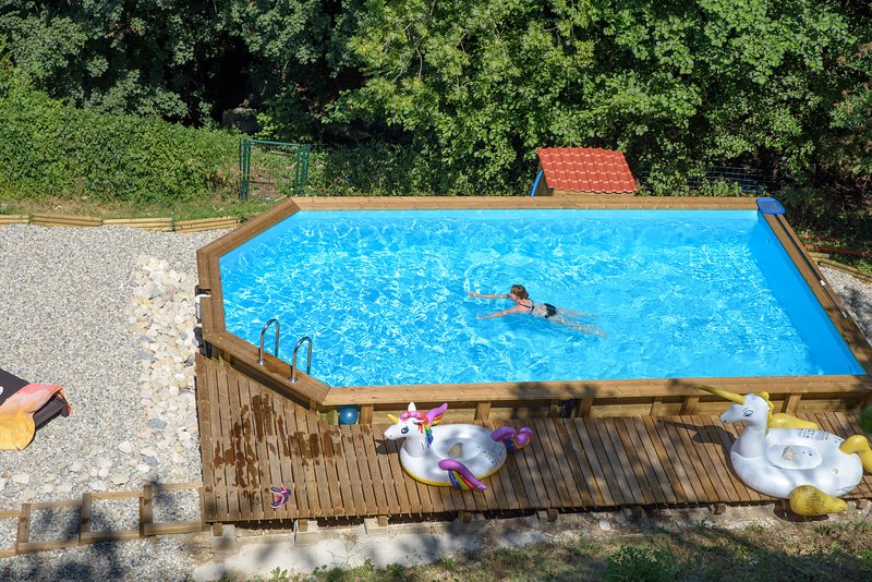 The 4m x 8m swimming pool with large beach area, 4 sunbeds and picnic table.