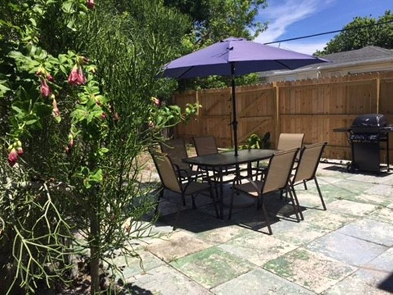 Gated large yard with BBQ and outdoor seating