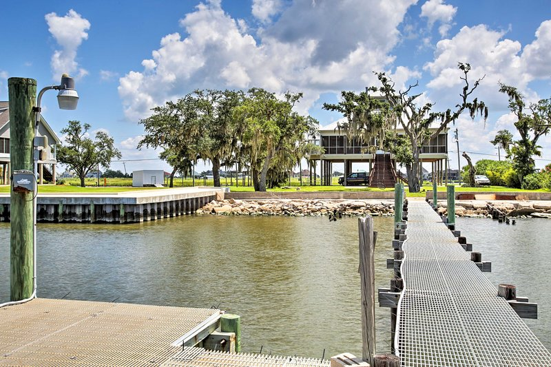 You'll find 3 bedrooms, 3 bathrooms, and a 120-foot pier at this stunning home!