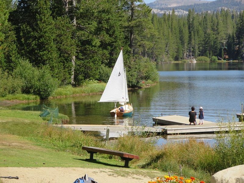 A dock adjoins the swimming beach at Serene Lakes, lot 1.