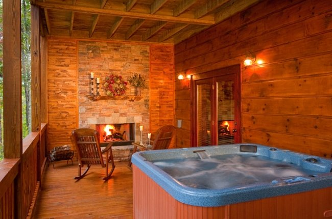 Romance and Luxury await in this 6-8 Person Hot Tub with the Glow of the Stone Gas Log Fireplace