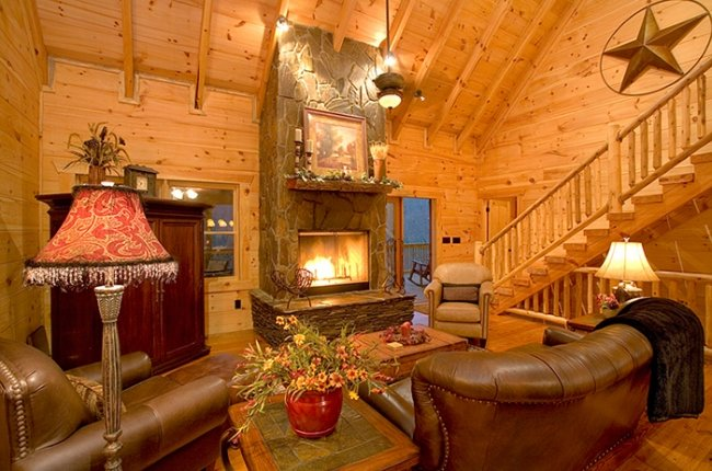 Stunning Living Area with Stone Wood-Burning Fireplace and Covered Porch Access