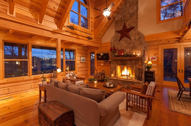 Living Area featuring Beautiful Stone Wood-buring Fireplace and Gorgeous Mountain Views