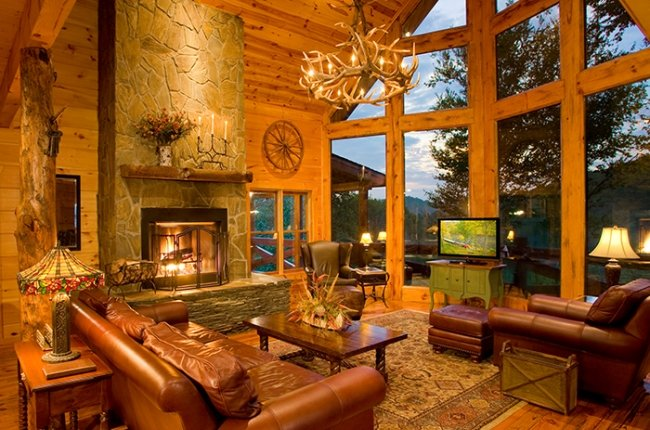 Great Room featuring Stunning Window Wall, Stone Fireplace & Leather Furnishings