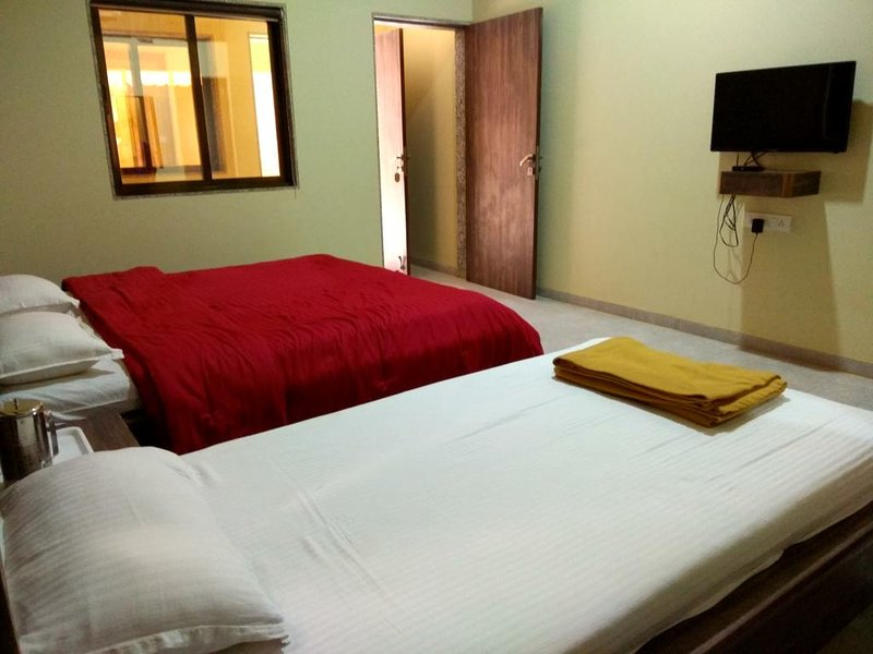 Ambassador Hotel - Deluxe Triple Room 2, holiday rental in Bhor