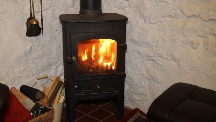 A wood burning stove creates a wonderful atmosphere. Logs and kindling are provided for your stay.