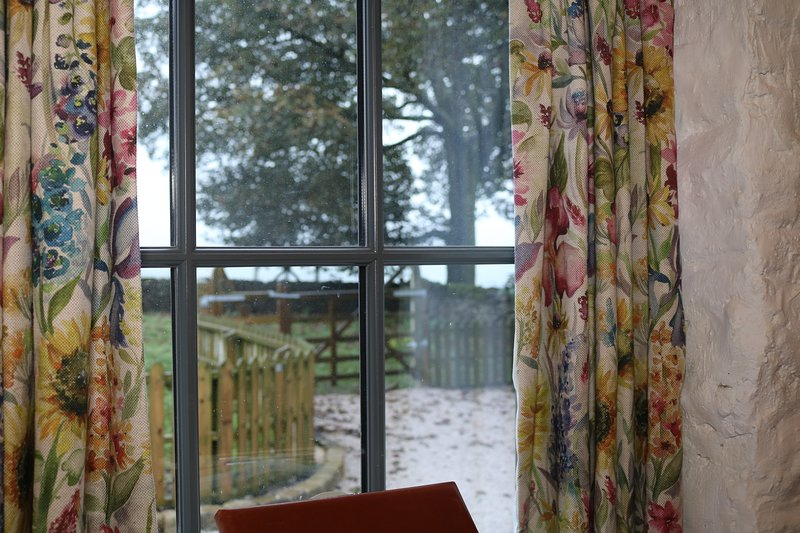 The wonderful view from the open plan living area, with views across the paddock.