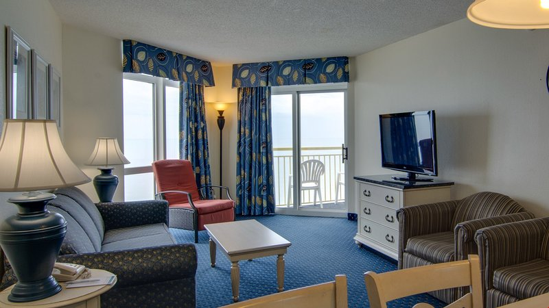 Walk out onto the oceanfront balcony or catch a show in the living room.
