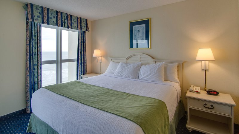 The master bedroom has a large king bed.