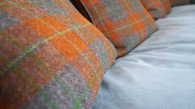 Genuine Harris Tweed soft furnishing and blinds throughout.