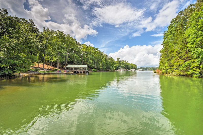 Your green oasis includes a private dock and kayak!