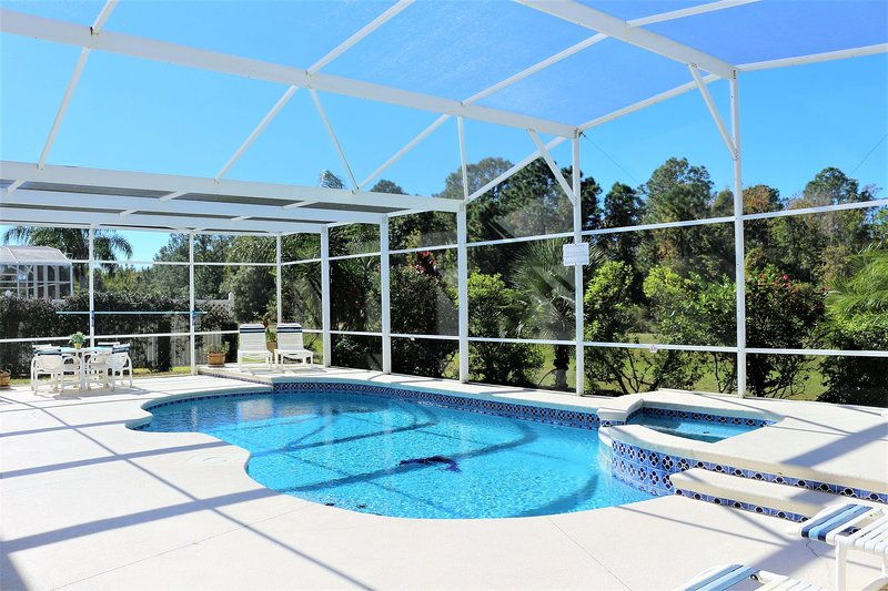 Sunny pool deck with private pool and spa