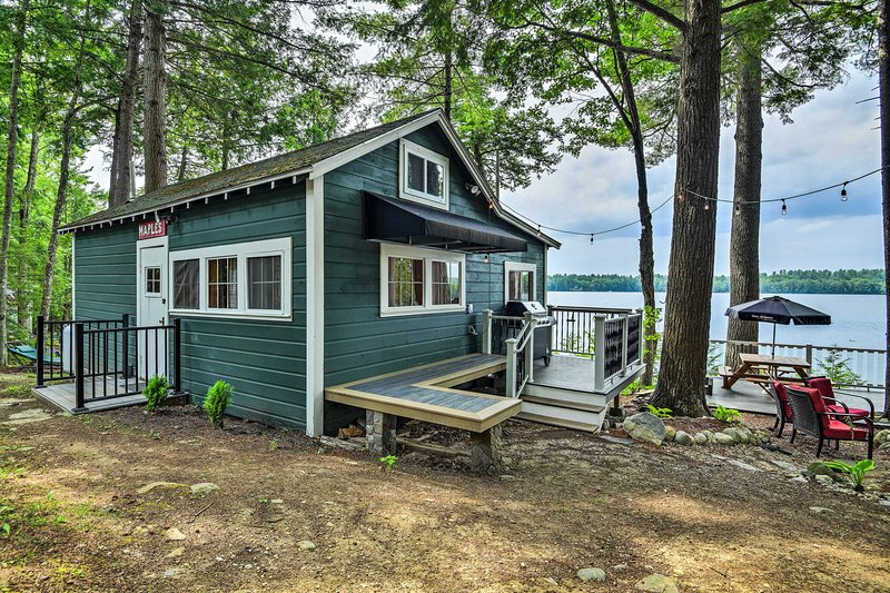 Explore Maranacook Lake from this waterfront Winthrop vacation rental cottage!
