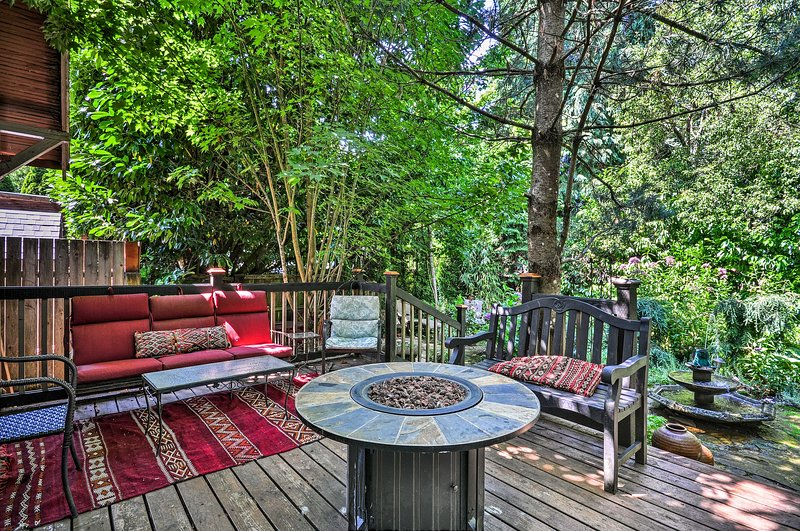 Enjoy a personal oasis with a private deck and beautiful surrounding gardens.