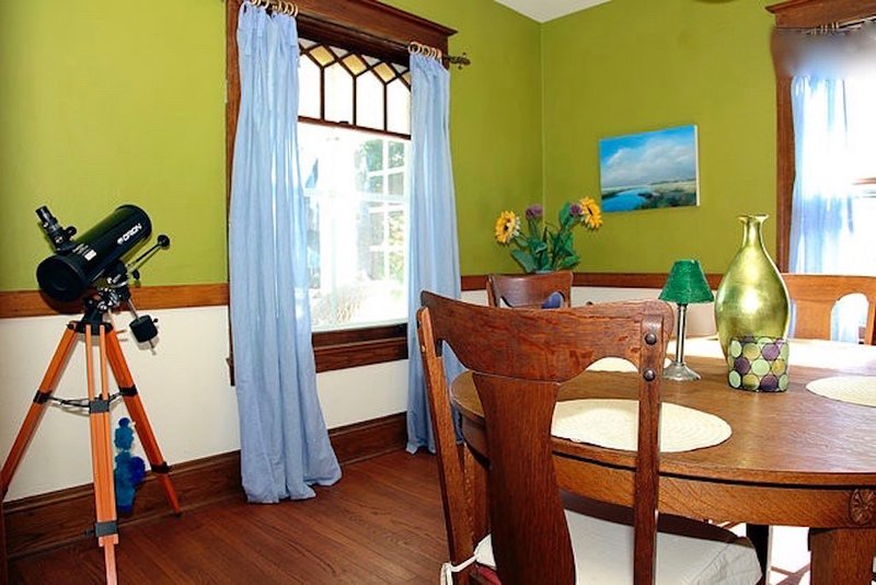 Share a meal in the DINING ROOM w/ french doors, original art and seating for 6