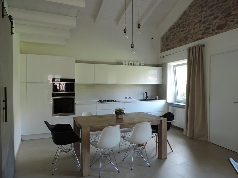Open plan living room with kitchen