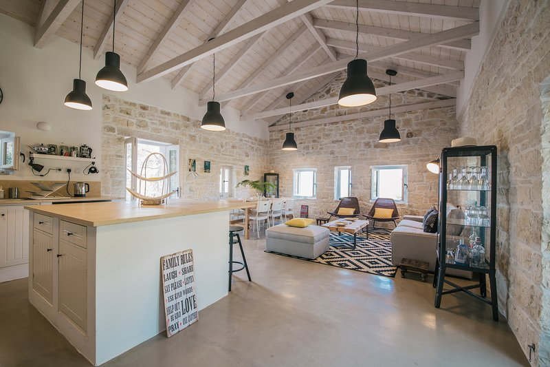 Paxos StoneHouse comprises a light, bright and contemporary open plan living space.