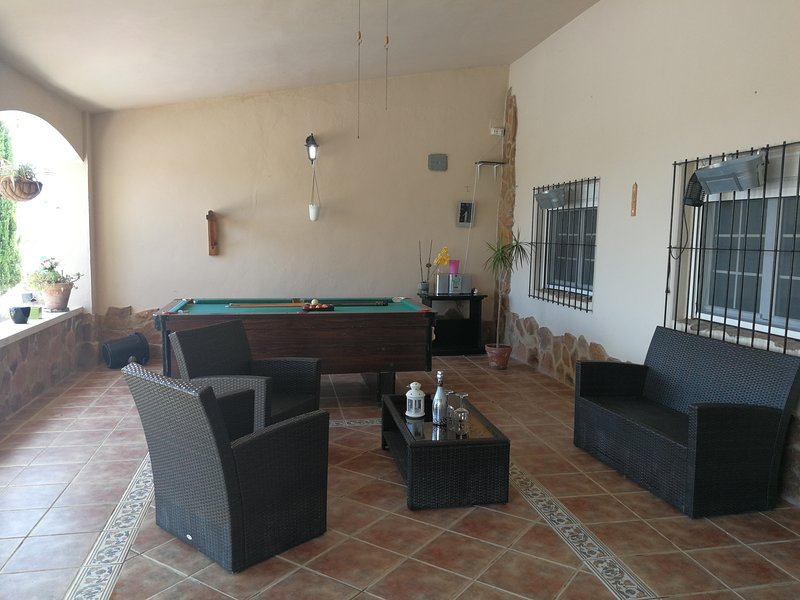 Very large porch with billiard table and chillout area