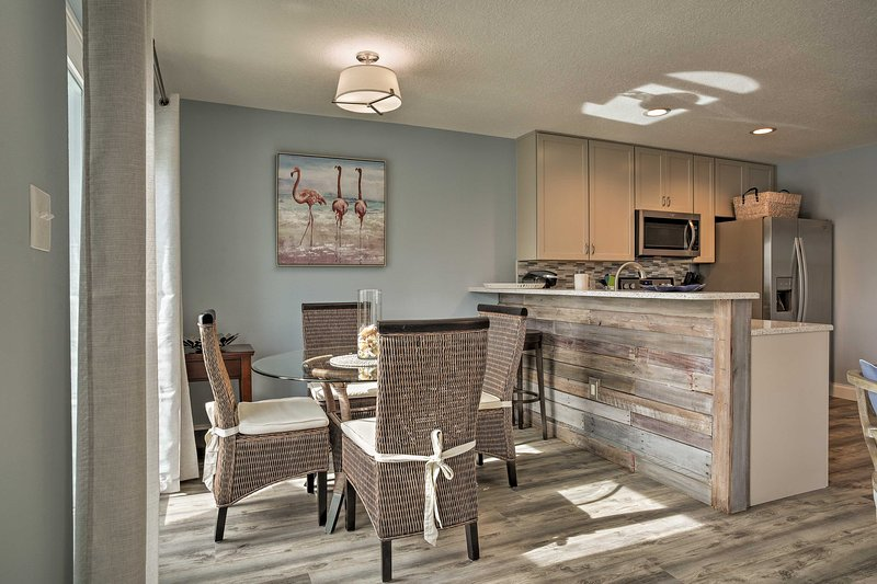 The unit features hardwood floors, nautical decor and an open-concept layout.
