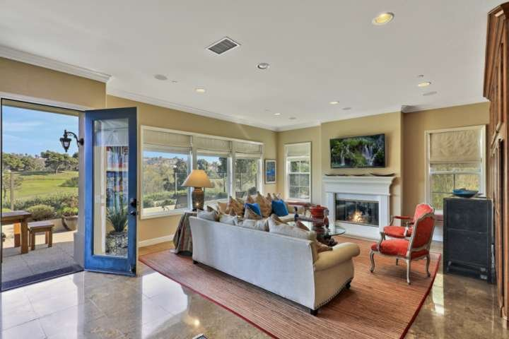 Family room with view of Monarch Links golf course - 2018