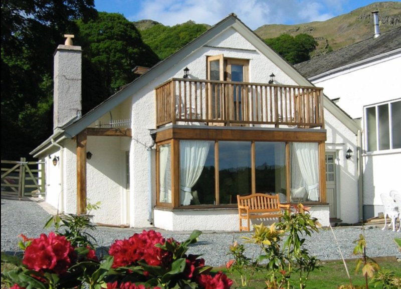 Private, sunny garden with superb views across Brathay Valley