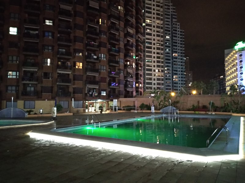 Illuminated swimming pools at night