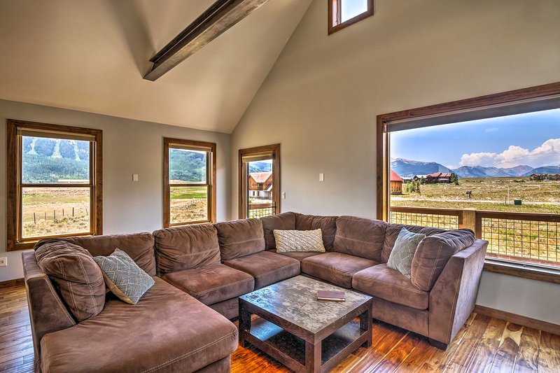 Various windows line the living room for natural lighting & spectacular views!