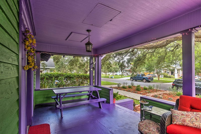 This eclectic hideaway includes a front porch and backyard!