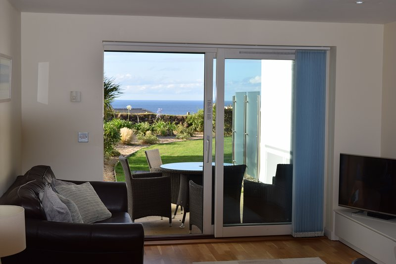Sea Shells is a ground floor garden apartment with lovely sea views and private patio