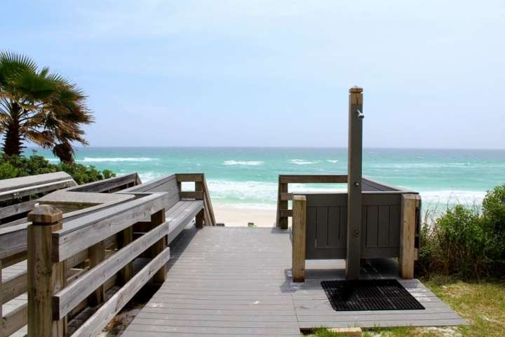24-steps down to the sugary sands of the Gulf of Mexico, and a shower available to rinse off before and after.