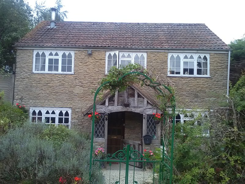 Detached stone country cottage with oak porch and gate