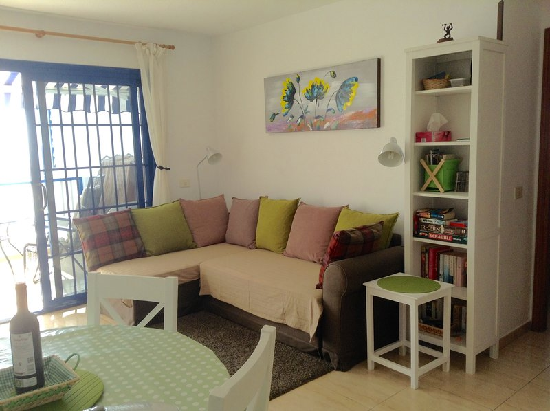 The lounge has a comfortable sofa which makes into a double bed