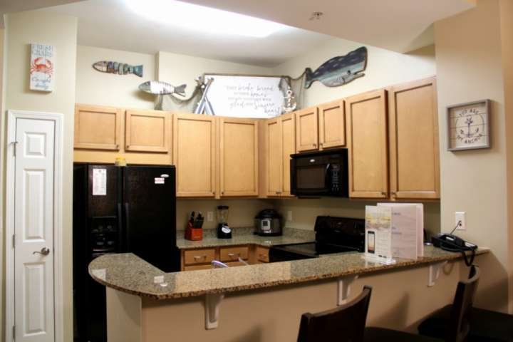 Nicely decorated kitchen with granite counter tops
