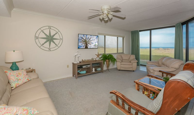 Oceanfront living room with flat screen TV, DVD and VCR.
