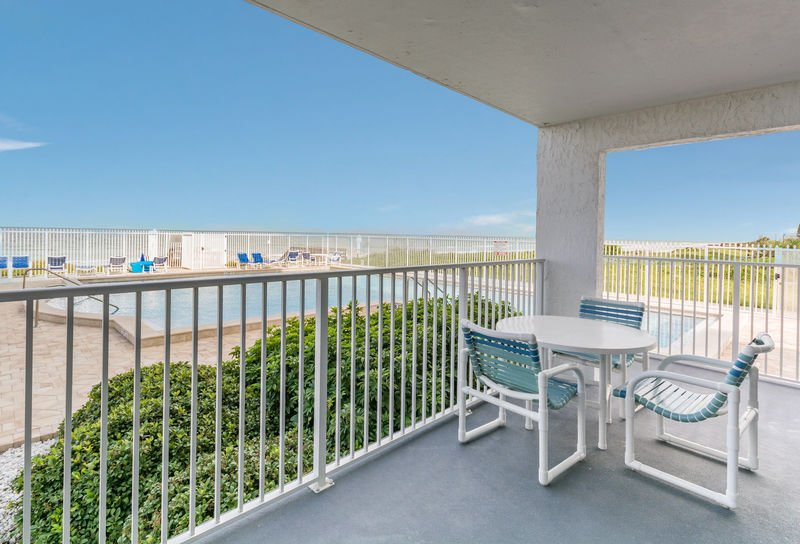 Escape the sun and relax on the oceanfront patio overlooking the pool area.