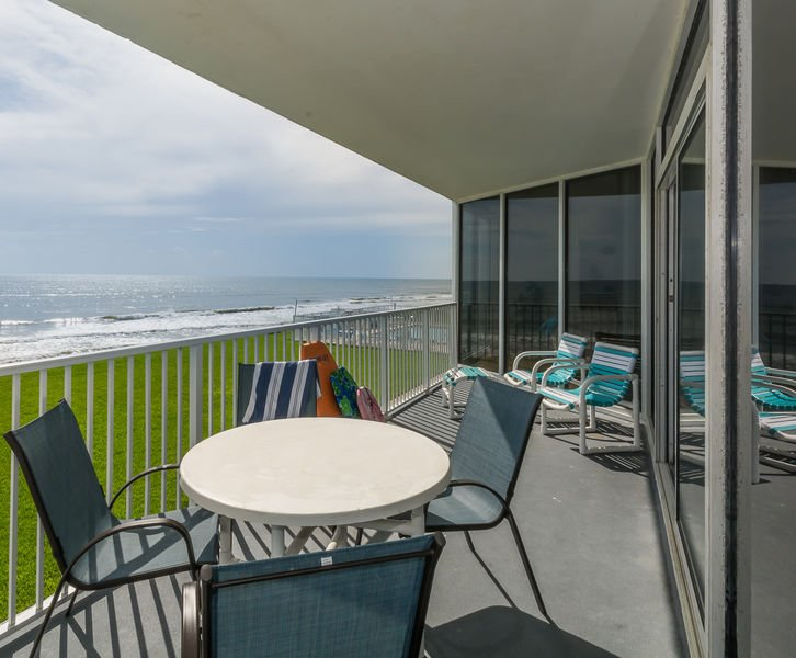 Kick your feet up and enjoy the ocean front view from the private balcony.