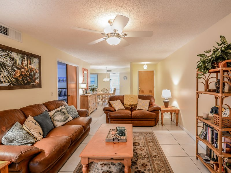Decorated with Florida style, this lovely living room features a flat screen HDTV, DVD player, leather couch and love seat.