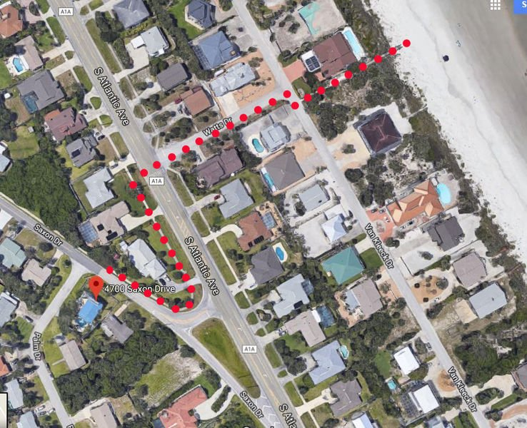 Getting to the beach is easy!  This red dotted path leads you to the beach access.  This home offers a wagon to pull your beach items along with you!