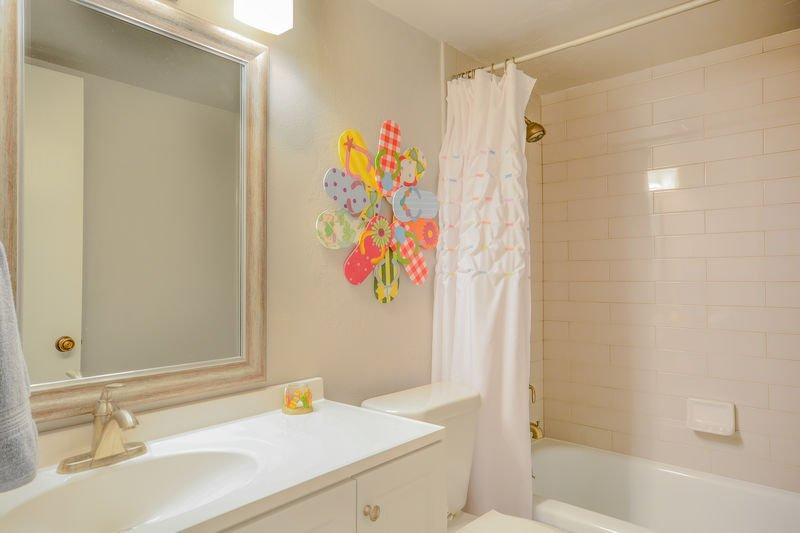 Guest bath with tub/shower.