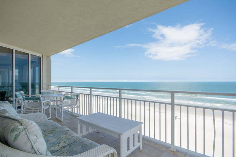 Enjoy the views from the oceanfront, wrap around balcony.