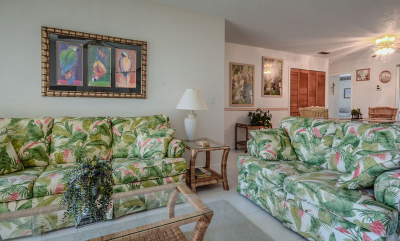 Enjoy the bright and beachy living room for relaxing or entertaining.