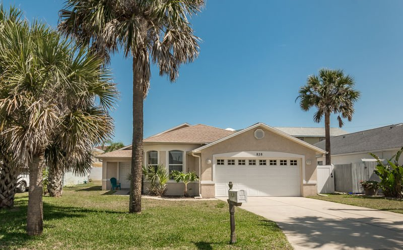 This 'beachy keen' 3 bedroom 2 bath home with a beautiful screened in pool is located at 828 Hope Ave.