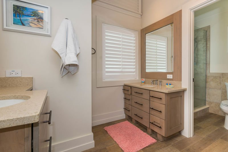 Shared, full bath located on the 3rd level featuring a walk-in shower.