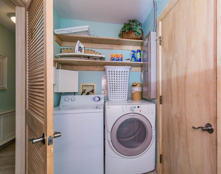 Laundry room with full sized washer and dryer.