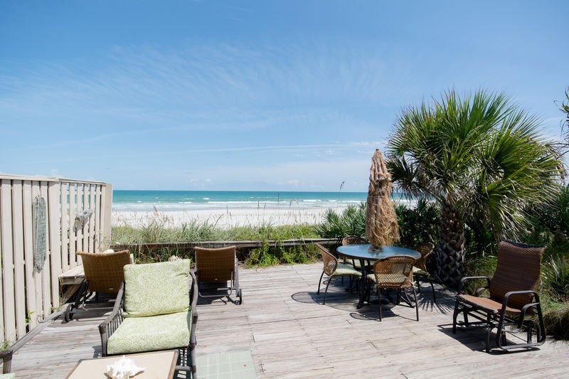 Oceanfront deck with plenty of room to enjoy the sunny Florida weather.