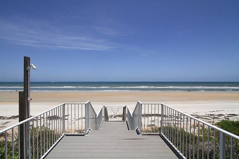 Large oceanfront deck with outside shower.